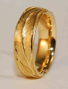 Commissioned Sculpted Wedding Ring featuring eucalyptus leaves in 18k yellow gold.