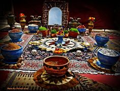 "Norooz - Persian New Year Festivities. Sitting around the ""sofra"" (tablecloth) placed on the carpet ... traditional style, old custom."