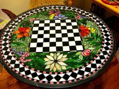 "Amazing mosaic game table! The artist is ""Elise""; can't find any more info."