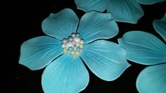 This is a listing for 12 3 gum paste flowers. The flowers are adorned with beautiful edible pearls. I can make any color/color combination you would