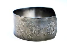 steel hare cuff, stainless steel bangle, medium surgical steel cuff. $31.00, via Etsy.