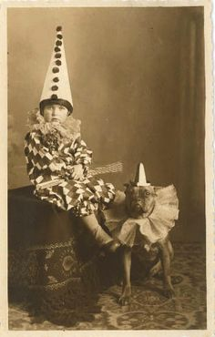 Vintage style circus ephemera or photobooth ideas.  Harlequiin or clown vintage style photo.  Dog in ruffled collar and child in pointy cone hat.