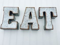 1 set of EAT or YUM Metal letters. Each letter is hollow and has built in notches for easy hanging or they can sit up on shelves or tables. Approximate dimensions for each letter are as follows: E Height: 7 Width: 4.72 Thickness: 1.75 A Height: 7 Width: 4.75 Thickness: 1.75 T
