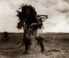 Yebichai Beggar Tonenili-Navajo Dressed Spruce. It was taken in 1905 by Edward S. Curtis.