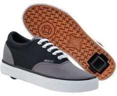 Adult heelys Shoes with wheels that look line vans.  Size 43/44