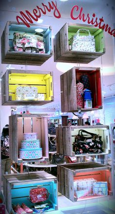 Gift ideas inside wood crates.  Cute, painted different colors inside.