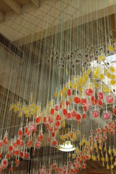 anthropologie lollipops on strings installation - cans on strings in colors? could be an awesome dividing screen