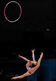 ♂ Sport Xiao Yiming (China) performs a ring leap with the hoop