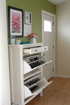 shoe organizer in the entryway! with an extra drawer for miscellaneous stuff - from IKEA..