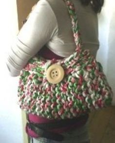 Fabric Knitted Bag @craftstylish: Summer inspired this bag was knitted & crocheted with recycled fabric with a tropical flower type print. It has a wood button on the front to close the bag and it has an inside cover in cotton fabric.