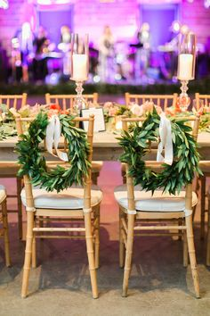 These wreaths on the bride and groom's chairs are so fun! Photo by Taylor Lord Photography. #chairdecor #wreath
