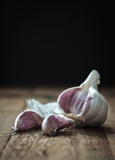 Garlic on wooden table - by Miroslav Jesensky