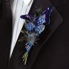 Wedding Boutonniere with Muscari accented with a tiny blue butterfly secured behind the flower
