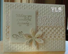 STAMPS: Lifetime of Happiness  PAPER: Classic Crest Baronial Ivory, Stardreams Ivory INK: Gold Encore ACCESS: ivory pearl confetti daisies, EK Success 6 petal jumbo daisy punch, Martha Stewart Garden Trellis punch, Cuttlebug Textured Tapestry and Dots embossing folders, glue dots