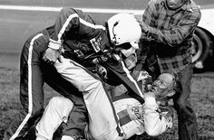 Tempers Flare & Fists Fly in 1979.  Bobbie Allison, defending his brother,  Donnie, & Cale Yarborough argue over whose fault a crash on the last lap of the Daytona 500 between leaders Donnie Allison and Cale Yarborough left their wrecked vehicles sitting on the grass.