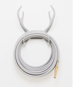 Reindeer Grey hose holder Graceful Rock colored garden hose - grey - buy online - we offer premium o Garden Hose Holder, Touch Of Gray, Mr Grey, Eucalyptus Leaves, Gardening Gloves, Wall Mounted Tv, Solid Brass, Reindeer, Cool Things To Buy