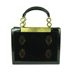 VINTAGE BLACK VELVET LEATHER PATENT EMBLEM GOLD HANDBAG  BUENOS AIRES-ARGENTINA    Fantastic handbag from Buenos Aires from the late 1950's! It has a wonderful shape. Both sides are velvet with deep gold emblems. The bottom and sides are trimmed in patent leather. The leather handles have round gold tone disks. The interior has two compartments, metal zipper pocket, pocket with attached coin purse. It has it's original mirror that is signed. Excellent condition inside and out. Nice to have…