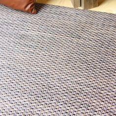 alfombra de vinilo en trenzado marrn y negro