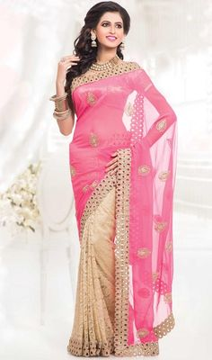 You look so charming wearing this beige and pink georgette, net half n half sari. The charming lace, patch, resham and stones work all through saree is awe-inspiring. Upon request we can make round front/back neck and short 6 inches sleeves regular saree blouse also. #CharmingPinkEmbroideredDesignOfSaree