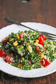 Kale Quinoa Tomato Corn Salad © Jeanette's Healthy Living. Super easy. I don't think the cheese was important.