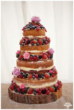 Definitely going to look at doing a log base! Wedding cake | Victoria sponge tiered cake with fresh fruit decoration