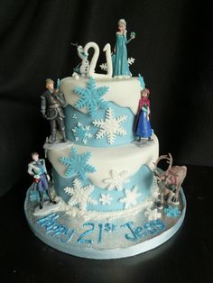Two tiers, snowflakes ? Must be a frozen cake. two tier frozen birthday cake