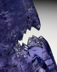 Etched Tanzanite crystal with a flattened, tabular form. Etched Tanzanites are not common and this one has an unususal shape.