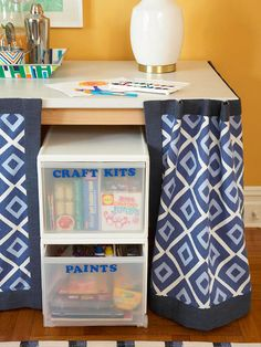 Turn a simple table into a storage gold mine with the addition of a skirt. For a DIY version, first cut and hem a piece of fabric to size. Then place hook-and-loop tape around the top edge of the table and attach the skirt. Slide storage bins or carts beneath the table.