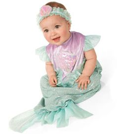 detailed description  trust us . . . your itty-bitty mermaid will make a splash wherever she surfaces. it doesn't get sweeter than this sparkly lavender and aqua bunting. look for organza ruffles and tail, and a headband with pretty soft shell adornment. polyester. imported. one size fits 6/12m.     2-pc. set includes:  - headband  - bunting
