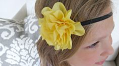This cute handcrafted baby headband features a 3.5 chiffon flower in yellow on a 1/4 black elastic. Perfect for photo props, special