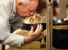 Pope Francis kisses the face of St Pius of Pietrelcina during the Year of Mercy…