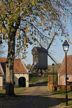 Fort Bourtange ~ Netherlands..View of the windmill from the village inside the fort.  (Photo by Foto Martien)