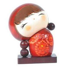 Kokeshi doll. S)