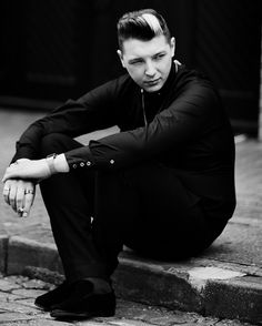 John Newman; casual form, sitting, clothing, accessories, hair, face, expression, hands