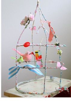 Make a wire and fabric bird cage / willowday. I could do this and make my own lamp shade frame