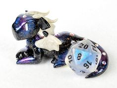 Galaxy dragon dice holder figurine - d20 dice guardian - star themed polymer clay dragon figurine - dungeons and dragons - DnD by HowManyDragons on Etsy https://www.etsy.com/listing/259168558/galaxy-dragon-dice-holder-figurine-d20
