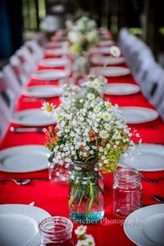 I purchased red tablecloths and am toying around with the idea of burlap runners with the mason jars... Maybe too much?