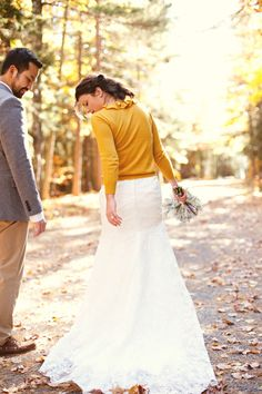 Wedding dress with a yellow cardigan.