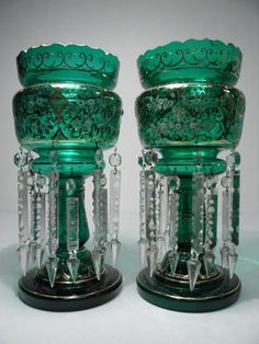 """Victorian green art glass mantel or """"mantle"""" lustres. Bristol style, each with 14 cut crystal prisms, hand painted florals, gilt highlights, and a scalloped rim"""
