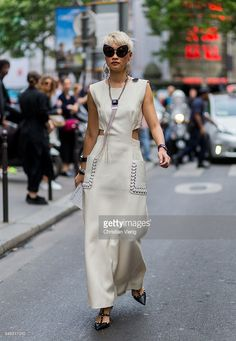 Esther Quek wearing a creme dress from Fendi and Valentino shoes outside Elie Saab during Paris Fashion Week Haute Couture F/W 2016/2017 on July 6, 2016 in Paris, France.
