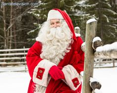 Santa Claus admiring his reindeer in the reindeer farm in Lapland, Finland