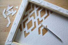 Gets ideas flowing! You could put another pattern of paper/wallpaper behind a punched out canvas or even solid paper to make the stencil stand out from the wall color too.