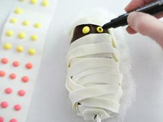 Mummy Snack Cake Pops   HGTV >> http://www.hgtv.com/design/make-and-celebrate/holidays/mummy-snack-cake-pops?soc=pinterest