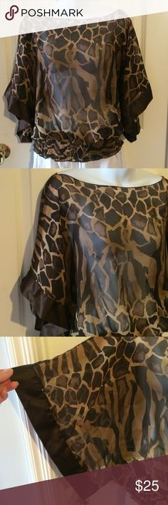Giraffe Print Sheer Kimono Style Top Perfect for warm weather days at Animal Kingdom or by the pool. Sheer brown giraffe print with ribbon trim 3/4 sleeves. Elastic block panel waist for great fit. Free size fits small to XL easily. Tops Blouses