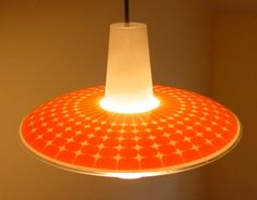 A light that looks like a space ship as it hovers over the dining room table!