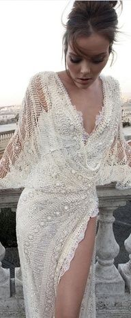 delicately gorgeous white lace gown. (Would make a good wedding gown without the slit...)