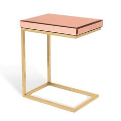 The Vivienne C Table is an ultra-useful workspace or end table because you can pull it up to a sofa a chair, or position over a chair arm -    anywhere and any time you need a useful slice of tabletop. An ideal working height, this C-shaped table spacious surface can hold your laptop,    dinner plate and wine; you get the idea. We know you use it a lot, so we created it as an elegant, stylized piece you love living with.    In a polished-gold finish over beautifully worked stainless steel...