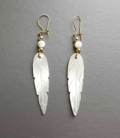 Vintage 80s carved mother of pearl feather earrings .. mop shell white jewelry
