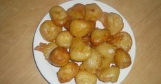 Photo courtesy Kaimati/sweet dumplings are delicacies famous at the coastal part of Kenya and parts of East Africa. They are star. Plane Snacks, Sweet Dumplings, Asian Recipes, Ethnic Recipes, Yogurt Cups, Fritters, Popular Recipes, Food Dishes, Snack Recipes