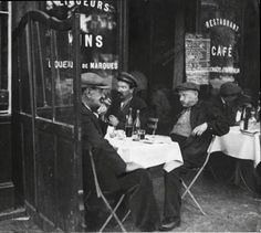 French men sharing a bottle of wine. Paris, 1920s